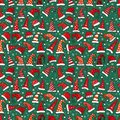 Seamless pattern with red Christmas Santa hats on dark green background. Vector illustration. Royalty Free Stock Photo
