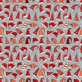 Seamless pattern with red Christmas Santa hats on grey background. Vector illustration. Royalty Free Stock Photo