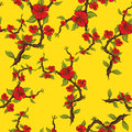 Seamless pattern of red flowers on a yellow background. Sprig of apple blossom Royalty Free Stock Photo