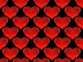 Seamless pattern of red glass hearts on a black background for your design Royalty Free Stock Photo