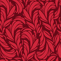 Seamless pattern with red and gold feathers Stock Images