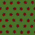 Seamless Pattern with Red Ladybugs and Ladybirds on a Dark Green Background. Royalty Free Stock Photo