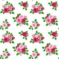 Seamless pattern with red and pink roses on white rosebuds green leaves a background Royalty Free Stock Photo