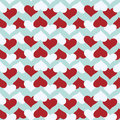 Seamless pattern with red and white hearts over blue background.