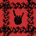Seamless pattern of rock and roll hand sign and fo footprints on a red background Stock Photography