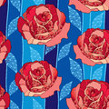 Seamless pattern with rose flower in red and blue ornate leaves on the dark blue background Royalty Free Stock Photo