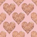 Seamless pattern with rose gold hearts. Pink Golden metallic textured background. Trendy template for holiday designs, St. Valenti Royalty Free Stock Photo