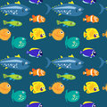 Seamless pattern with sea fish on a blue background Royalty Free Stock Photo