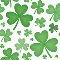 Seamless pattern of shamrock shapes green varying sizes with white background Stock Images