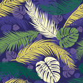 Seamless pattern with silhouettes of palm tree leaves. Seamless Floral Background. Royalty Free Stock Photo