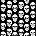 Seamless pattern from skulls on black background grinning Royalty Free Stock Image