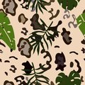 Seamless pattern of snow leopard skins and tropical leaves. Vector template