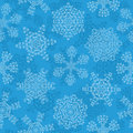 Seamless pattern with a snowflakes Royalty Free Stock Photography