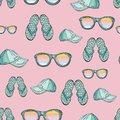Seamless pattern of summer clothes isolated on a pink background