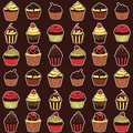 Seamless pattern with sweet cupcakes vector texture for wallpapers fills web page backgrounds Stock Photos