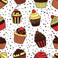 Seamless pattern with sweet cupcakes vector texture for wallpapers fills web page backgrounds Stock Images