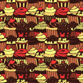Seamless pattern with sweet cupcakes vector texture for wallpapers fills web page backgrounds Royalty Free Stock Photos