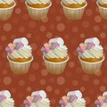 Seamless pattern with sweet cupcakes. Yummy dessert can be used for textile printing, ads, birthday greeting card, the childrens m Royalty Free Stock Photo