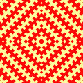 Seamless pattern with symmetric geometric ornament. Red counter embattled lines on yellow background. Heraldry motif. Royalty Free Stock Photo