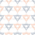 Seamless  pattern. Symmetrical geometric background with red and blue triangles in the shape of stars on the white backdrop. Royalty Free Stock Photo