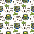 Seamless pattern with tea cups and calligraphy decoration. Watercolor texture for menu or wrapping design.