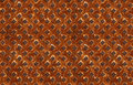 Seamless pattern of textured rusty metal with diagonal grid Royalty Free Stock Photo