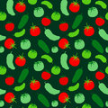 Seamless pattern with tomato and cucumber on a green background