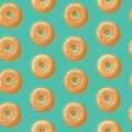 Seamless pattern, top view of fresh bagels with white and brown sesame seeds. Vector illustration.