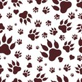 Seamless pattern of traces of dog`s paws. Vektor