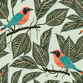 Seamless pattern with tropical birds and plants. Exotic flora and fauna.