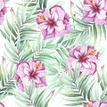 Seamless pattern with tropical flowers and leaves. Watercolor illustration.
