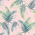 Seamless pattern with tropical leaves. Dark and bright green palm leaves on the light pink background.