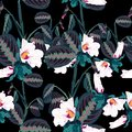 Seamless pattern with tropical leaves and exotic white hibiscus flowers. Dark palm leaves on the black background. Royalty Free Stock Photo
