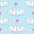 Seamless pattern. Two white swans. The birds in love swim in the water. The sun in the shape of the heart. Romantic love. For gift