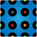 Seamless pattern of vinyl records on a blue background Stock Images