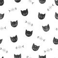 Seamless pattern with watercolor black cats and fishbones.