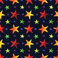 Seamless pattern with watercolor colorful stars on navy blue background