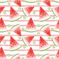 Seamless pattern of watercolor drawings of red watermelon slices and pink stripes
