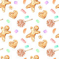 Seamless pattern with watercolor gingerbreads and marshmallow