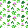 Seamless pattern with watercolor leaves and flowers of clover for design