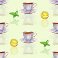 Seamless pattern with watercolor porcelain tea cups, lemon and m