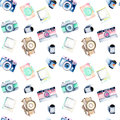 Seamless pattern with watercolor retro cameras, snapshots and films