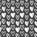 Seamless pattern of white hearts on black hand painted a grungy background Royalty Free Stock Photo