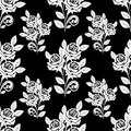 Seamless pattern with white roses on the black background is presented Stock Photo