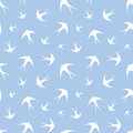 Seamless pattern with white swallows on blue. Vector illustration. Royalty Free Stock Photo