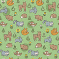 Seamless pattern of woodland creatures on a green background Royalty Free Stock Photo