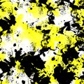 Seamless pattern of yellow and black watercolor blots