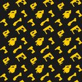 Seamless pattern yellow power tools on dark background