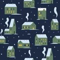 Urban evening winter landscape with various buildings. Little cute town in snow. Winter houses for Christmas fabrics and decor. Royalty Free Stock Photo