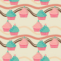 Seamless pink and blue cupcakes Stock Photography